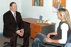 Dr Trevor Rock in consultation with a patient at the Toowoomba Chiropractic Centre
